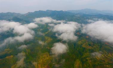 Aerial view of morning mists casting over Dali Village in SW China's Guangxi